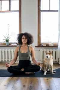 woman and dog meditating