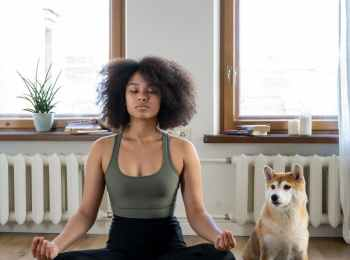 woman and dog meditating