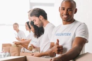 Volunteers packaging food for food drive